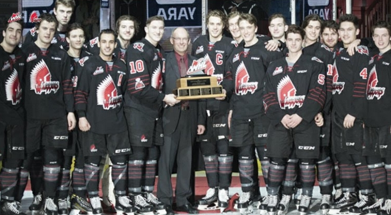 Photo: Andy Hamilton Photography  The Warriors and WHL President, Richard Doerkson, posing with the Scotty Munro Memorial Trophy