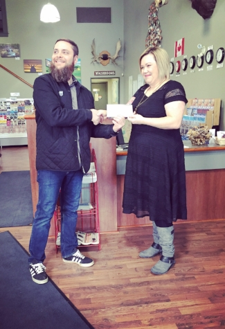 Chad Klyne accepting the top prize from Jacki L'Heureux