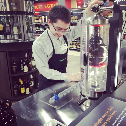 Sean Isbister filling a jug at Sobey's 16 tap growler bar