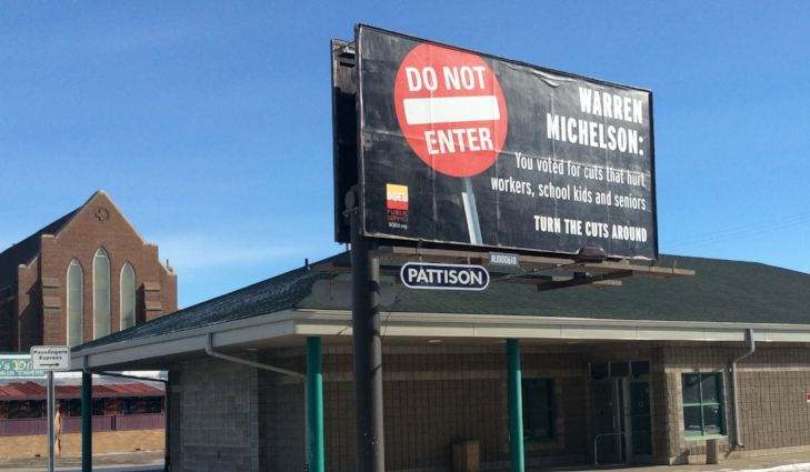 Billboard, in front of the Greyhound Station, on High St.
