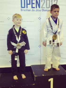 Dominic Myers (left) won silver in the the boys 7-8 roosterweight division