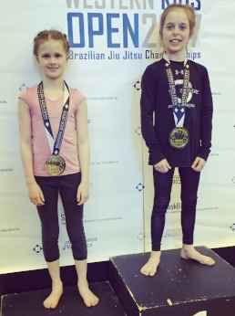Kenzie Woods (left) took home silver in the 9-10 girls roosterweight division.