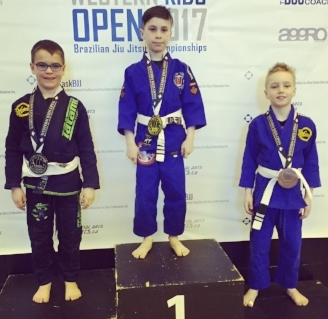 Preston Wilgosh (left) and Roque Spaan-Murray (right) took home silver and bronze, respectively, in the boys 7-8 featherweight division. In the centre is Oliver Fayant, from Complete MMA in Regina who beat them both to take home the gold.