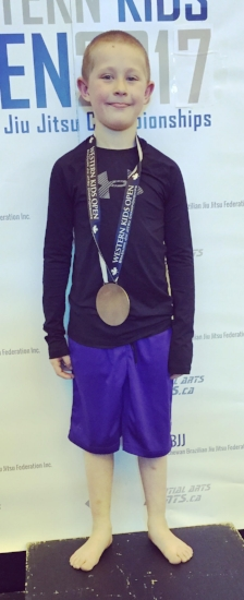 Vander Woods with the bronze medal he won in the boys 7-8 No-Gi featherweight division.