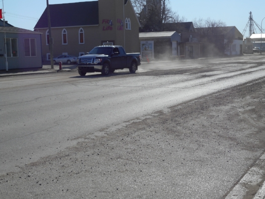 Vehicles can't help but kick up dust