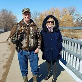Larry and his wife Norma with Puff the Prairie Falcon at Wakamow.