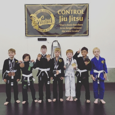 From Left to Right: Wyatt Johnson (2 Bronze),  Asher Booth (1 Silver, 1 Bronze), Carter Beliveau (2 Bronze), Colton Bevan (1 Silver, 1 Bronze), Paxton Nelson (1 Gold, 1 Silver), Yuan Harvey Fabellon (1 Bronze), Roque Spaan-Murray (2 Bronze).  Absent from photo: Kenzie Woods, Vander Woods and Julia Wilson