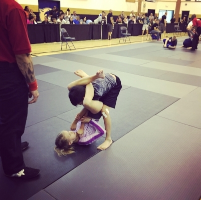 Kenzie Woods working a triangle choke in a match against her teammate Harvey Fabellon.