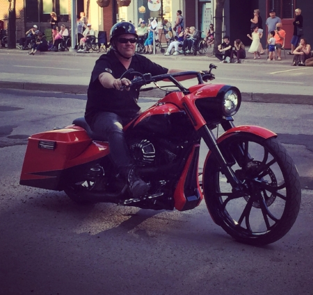 Brandon Richardson, owner of Deja Vu Café, out for a ride on his hog.