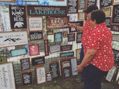 Angie Arndt at  Country Angel Rustic Décor  has been making signs like these for over 20 years now. She designs her own stencils and comes up with some of the text you can read on her signs as well.