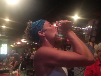 Angie drinking from the Trivia Night Cup. The Holy Grail of Festival of Words treasures.