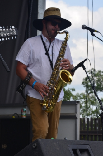 Library Voices has a horn section. Here is Mike Thievin on the Saxophone