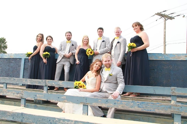 The wedding party, in the same bleachers in which I last saw Lyle Helland