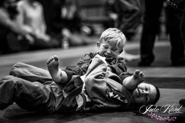Dominic Myers captured a pair of Silver Medals. Here he is working an arm bar on Tysen Holowatuk.    Photo Credit:  Jode Kivol Photography
