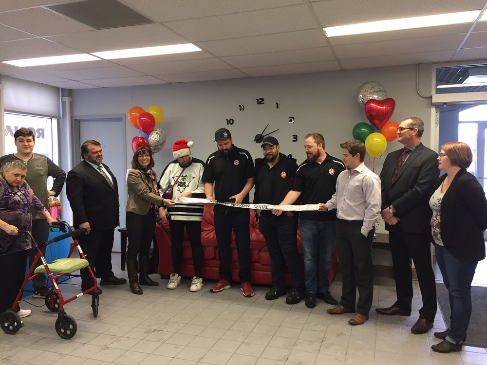 In the ribbon cutting photos are, from left to right, Paulette Mulholland, Dylan Lamb, Greg Lawrence MLA, Crystal Froese Moose Jaw City Council, Tom Shelly, Jeremy Hansen (Moose Jaw Kinsmen), Jamaal James (Moose Jaw Kinsmen), Danny Stenko (Moose Jaw Kinsmen), Matt Sapp (Moose Jaw Families Board Chair), Mark Sture (Moose Jaw Families Vice-Chair), Kirsten Senior (Moose Jaw Families Board of Directors).