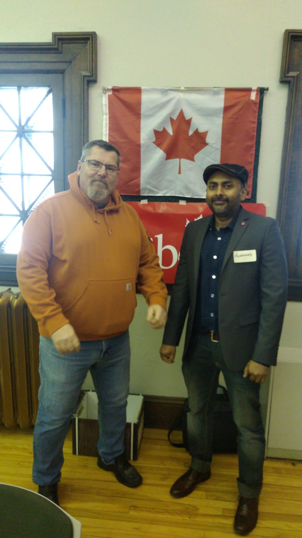 Outgoing riding chair Ross Collicott (left) and new riding chair Muhammad Yousuf Qasmi