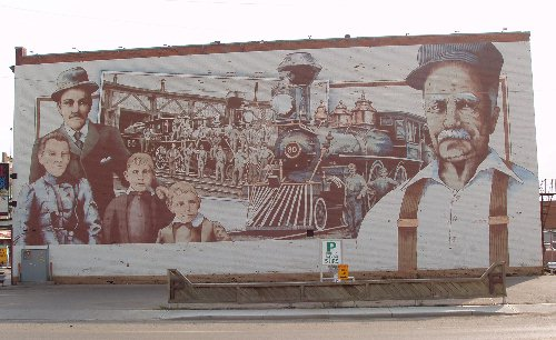Old Number One was the first mural commissioned in Moose Jaw. It use to adorn the west wall of the former Royal Hotel on River Street. The hotel was demolished to make way for a new hotel development which never occured.