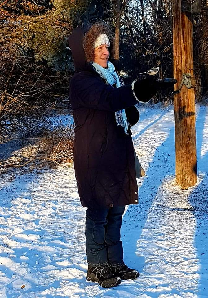 """New member, Patti Kosteniuk - """"I couldn't get the smile off my face feeding the birds, and watching the joy on kid's faces when they had a bird eating out of their hands."""""""