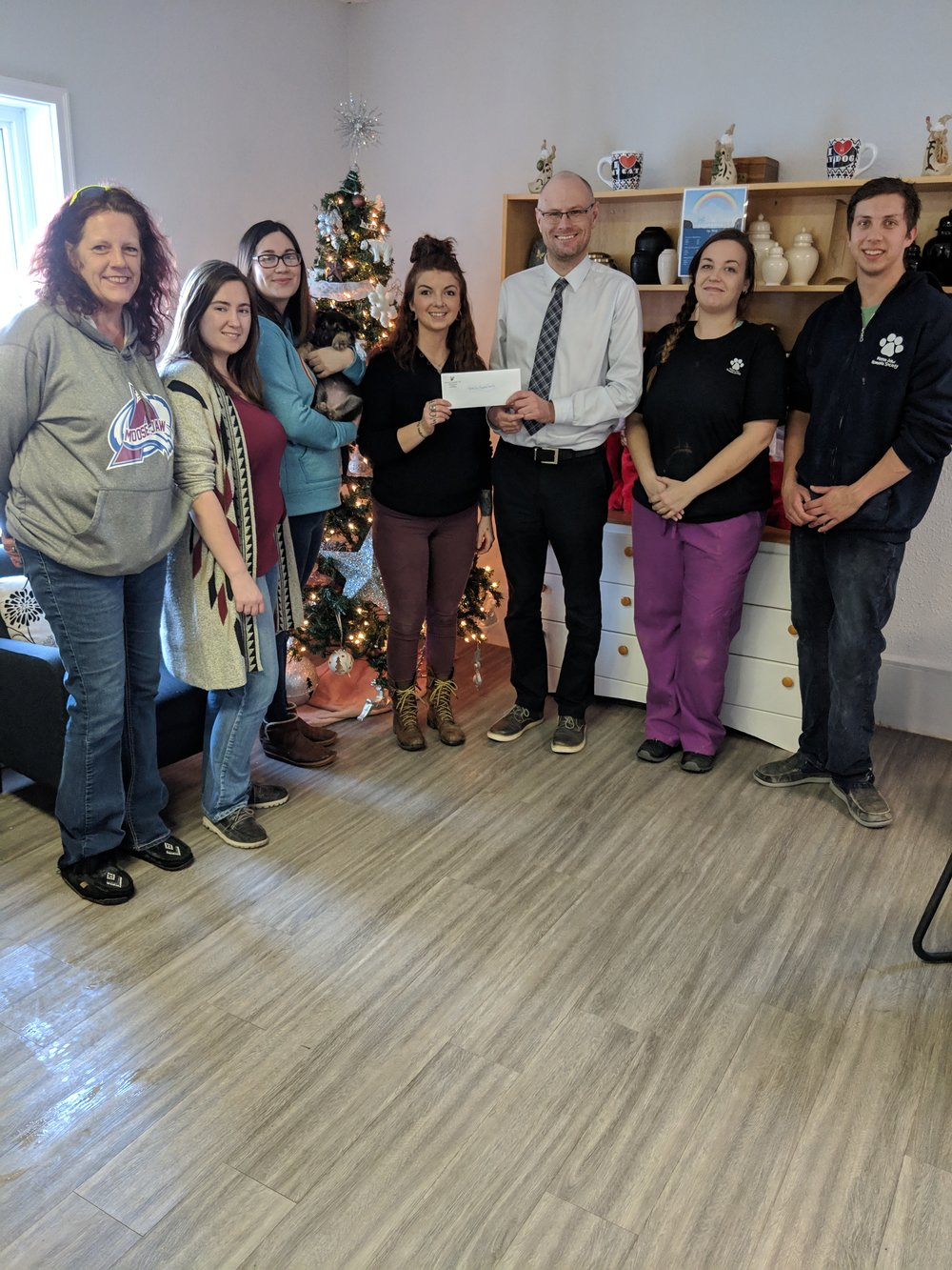 City employees present a cheque to the Moose Jaw Humane Society