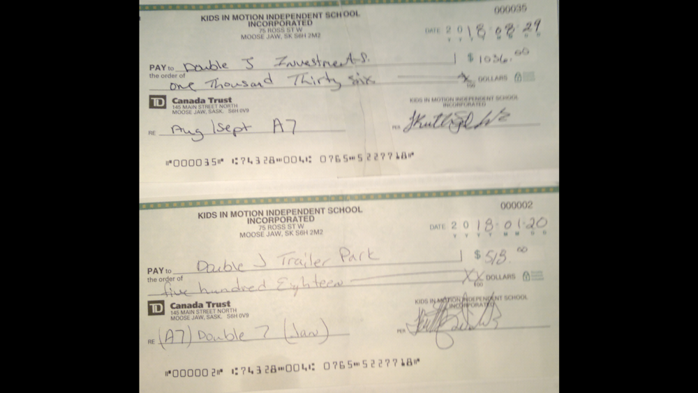 Two cheques - one to pay trailer court rent in January 2018 and two months in August and September 2018