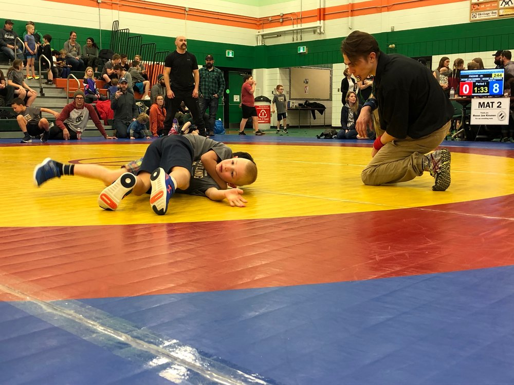 Fighting off being pinned is Kainen McKee - Hoy Hill Photo