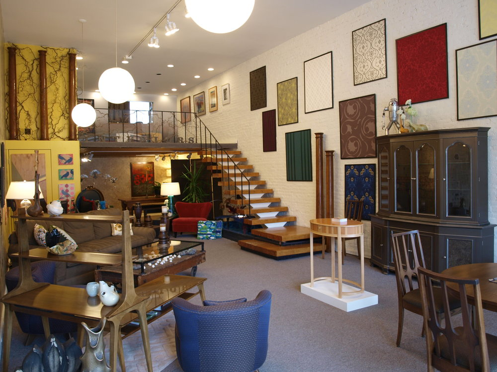 Photo of Hazel Tree on opening day eight years ago, featuring antiques, mid-century modern furnishings, architectural relics, framed wallpaper samples, and local art.
