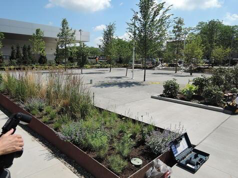 """A view from the upper area of the garden. My favorite elements here are: the crushed granite surface as a permeable pavement that allows water to seep through, water plants, and prevent run-off, but still be an ADA-accessible surface for mobility; and Mark's comment that this garden design started from the approach that this was a community space first and a space to view the sculptures second. As Dominic Caruso,Design, Marketing and Communications Coordinator for the museum said, """"This is a love letter to Akron."""""""