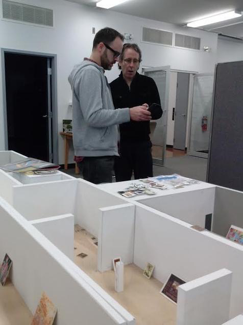 Chris Ross, Preparator, and Arnie Tunstall, Collections Manager, discuss an upcoming exhibition.