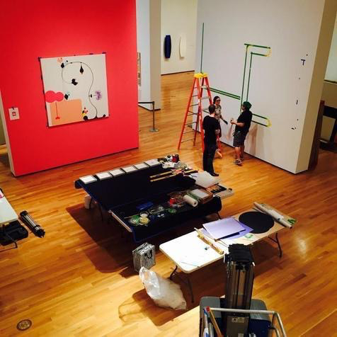 "A view from Joe Walton's world....high on top of a pneumatic lift inside the gallery as they install the next exhibition, ""Beauty Reigns."""