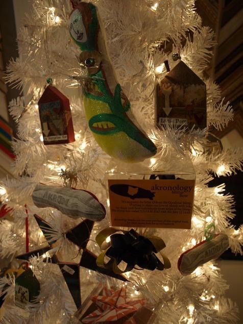 """2013 holiday ornaments available. The """"blimp bows"""" in the clear box are made from an actual Goodyear blimp! The folks at Akronology who make them were given one of the 10 foot tall """"O's"""" from a retired blimp."""