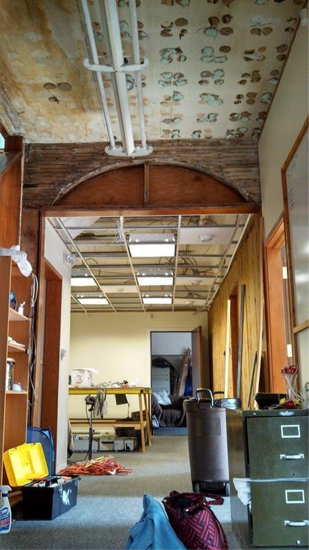 She wants the ceilings as high up as they can go; some walls on the right will be removed to open up the space; her workroom will be in the back.    Imagine dark floors and crisp, light walls...ooh la la...
