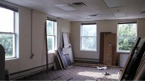 The first of two apartments upstairs will have an open floor plan, except for the bedroom and bath. The kitchen will be on the back left of this area, the dining area on the front left shown, and a living room area will be around the corner on the right.    Just look at all that natural light!