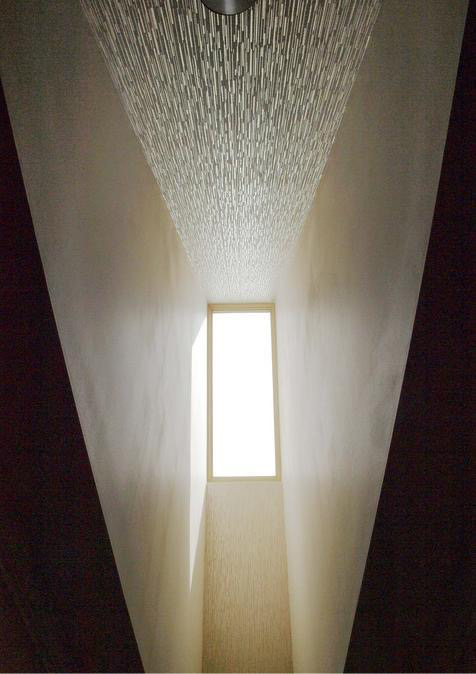 View looking up into the skylight. The metallic wallpaper from Romo was so much fun when the sun hit it!