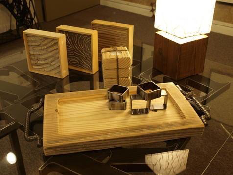 Natural materials make up gorgeous pieces like serving trays, napkin rings, lamps, candle holders, and wall art smalls.