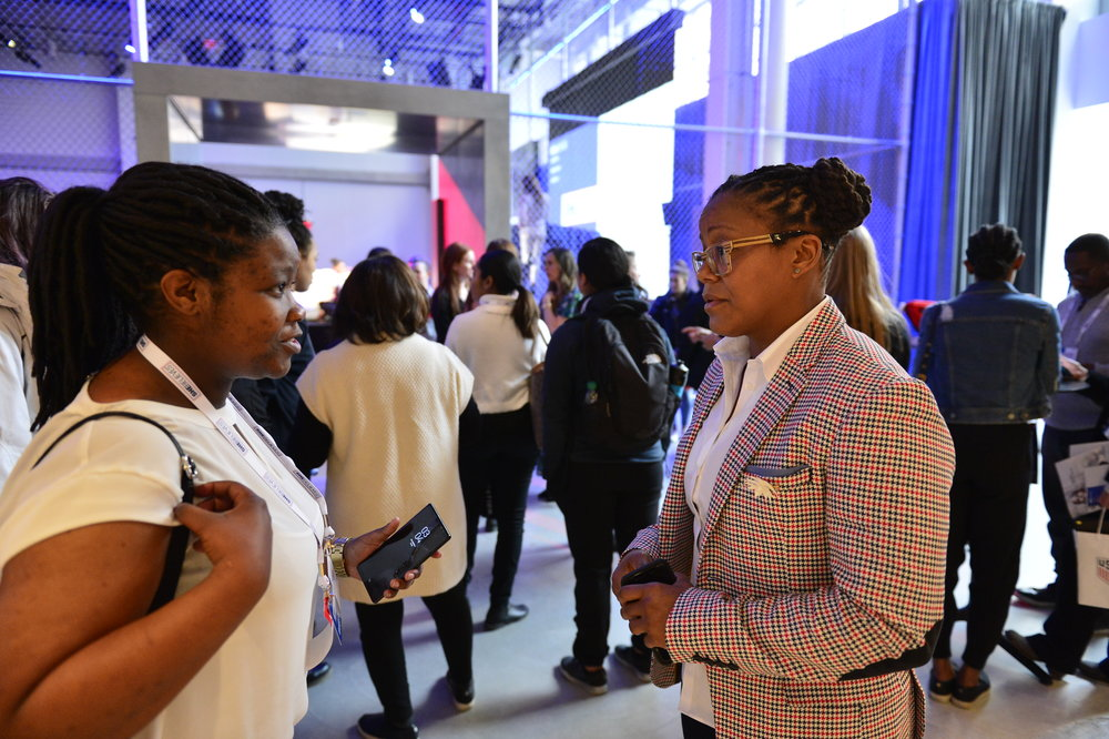 Phaidra Knight speaks with a SheBelieves Summit attendee.