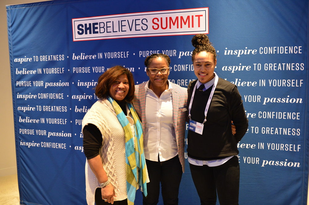 Phaidra Knight takes a photo with SheBelieves Summit attendees.