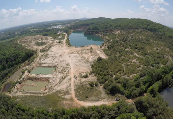 BUCKHORN SAND MINE  Disposition of 115 Acres of Industrial Land