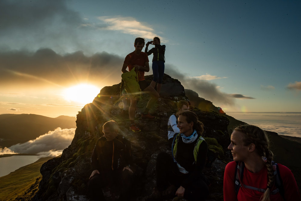 Runners at the summit of Slættaratindur, the highest mountain of the Faroe Islands  Photo by David Altabev