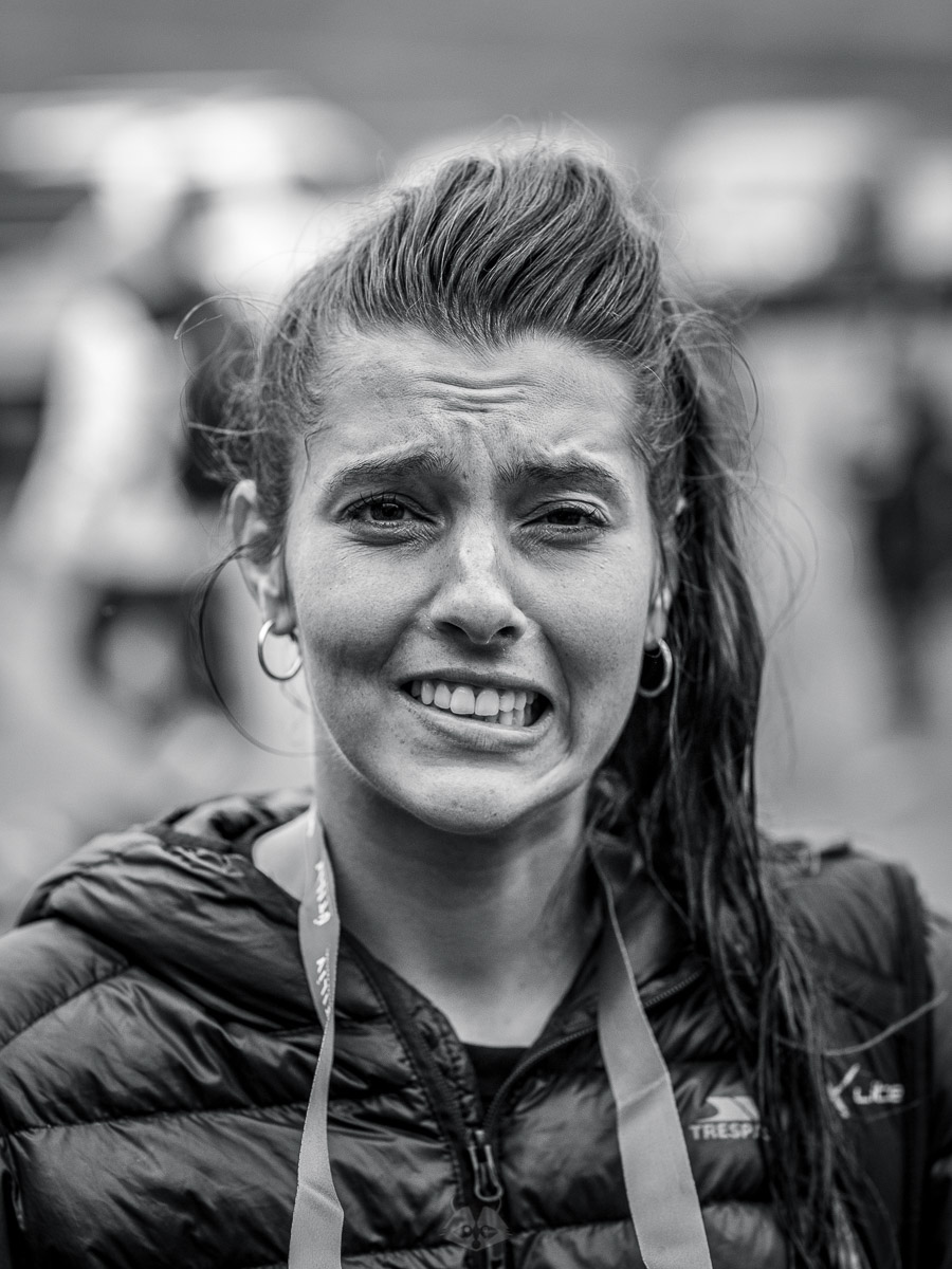 Harriet showing her finishing expression of the Útilív Mountain Half Marathon  Photo by Scott Seefeldt
