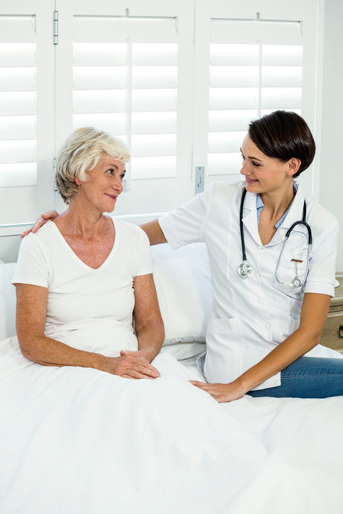 Smiling-female-doctor-with-senior-woman-at-home-667778504_485x727 (1).jpeg