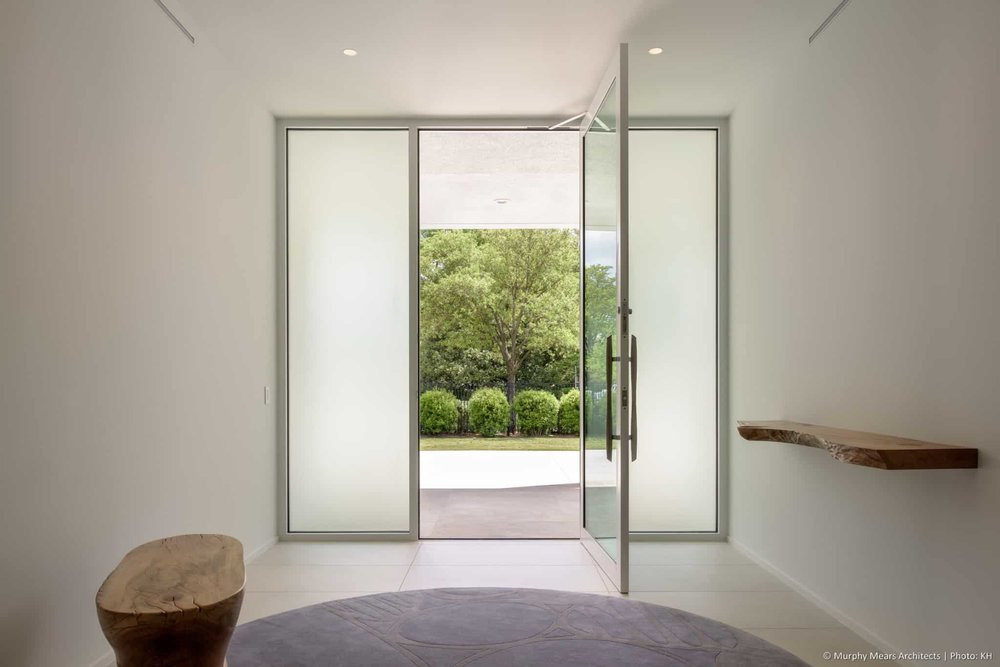 w-mid-century-modern-home-neuhaus-harwood-taylor-renovation-alumnium-storefront-entry-door.jpg