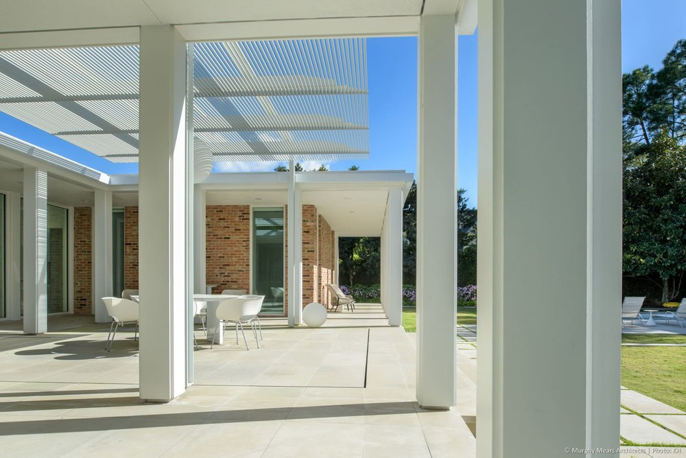 w-mid-century-modern-home-neuhaus-harwood-taylor-renovation-columns-limestone-trellis.jpg