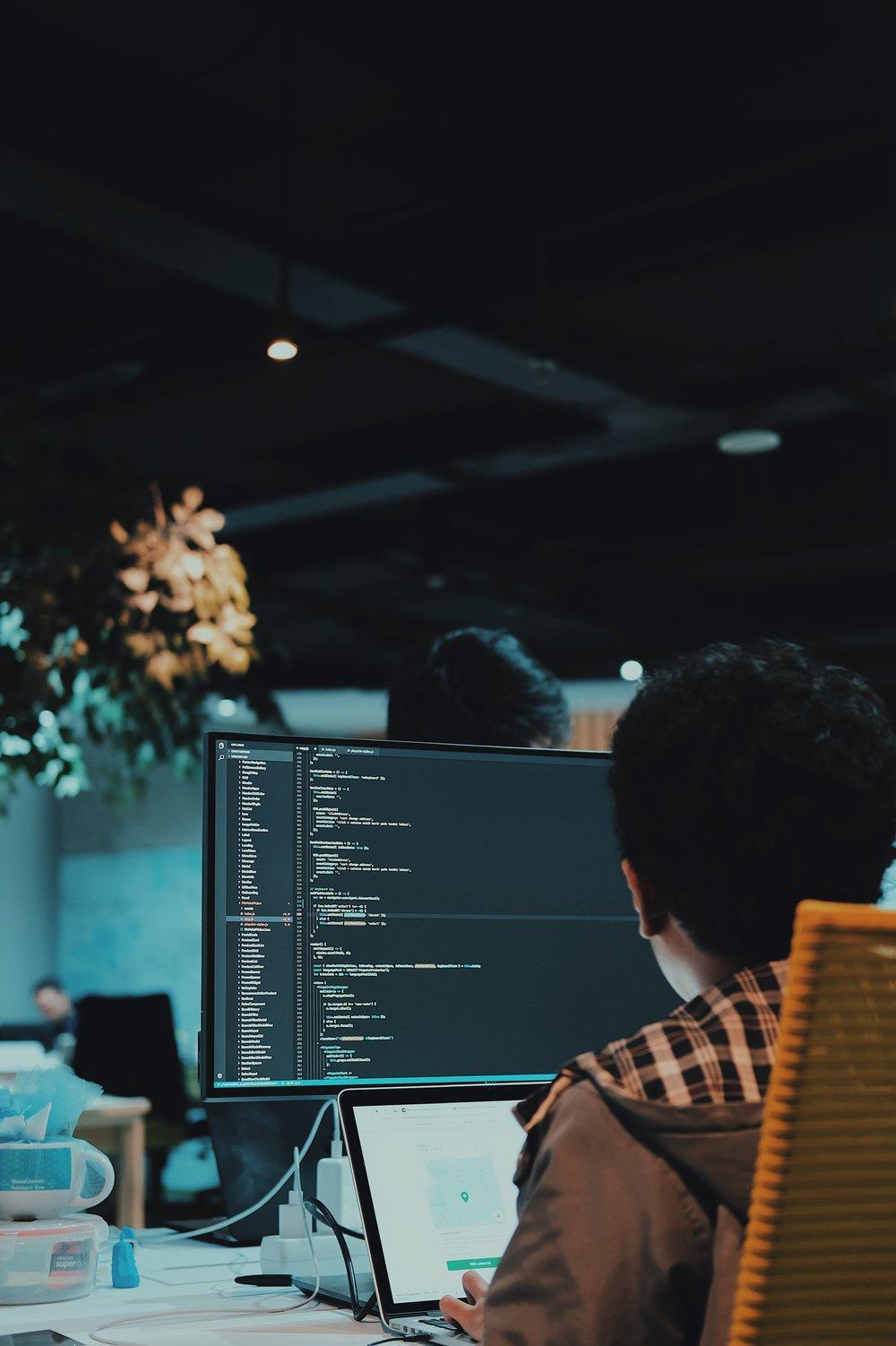 A developer coding a program