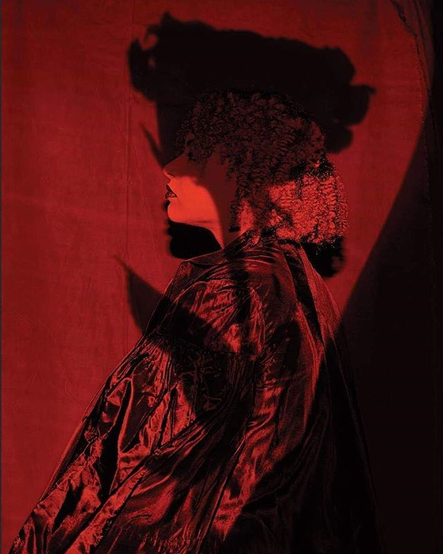 """""""The shadow of a rose overlaid over Theresa's piece represents the false beauty ideals we put on ourselves and others. The image is painted red for intensity and her profile mirrors the famous profiles represented so often in coins, connecting capitalism to beauty."""" Full Moon Full Hearts. Set design @daepai  Photography @yannvoljean  Wardrobe @diseiye_"""