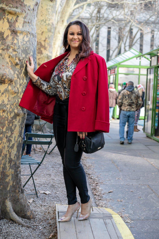 Outfit Details: - Red Jacket: Vintage Victoria's SecretMulti-Color Bodysuit: FashionnovaCrossbody Bag: Jessica SimpsonBlack Knot-Front Pants: FashionnovaClear/Gold Heels: Miss Lola (no longer available)