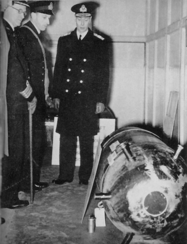 King George VI viewing Ouvry's mine at HMS VERNON on 19 December 1939