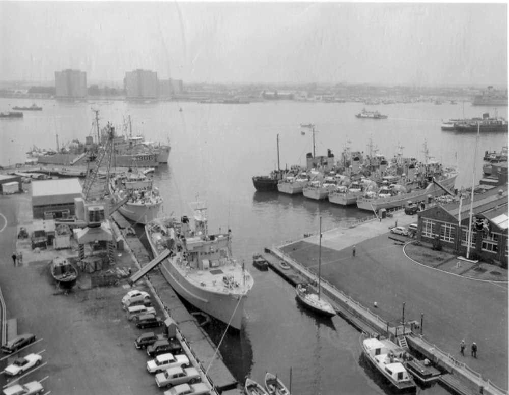 Copy of HMS VERNON's diving training tender HMS Laleston with RN, RNR and NATO Mine Countermeasures vessels berthed at HMS VERNON in 1974