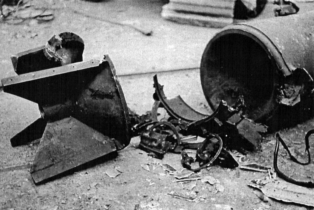 German mine after explosion of booby-trap