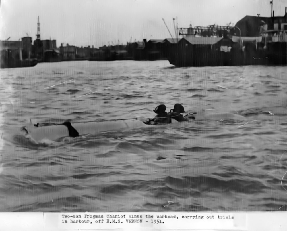 Chariot two-man human torpedo in Portsmouth harbour off HMS VERNON