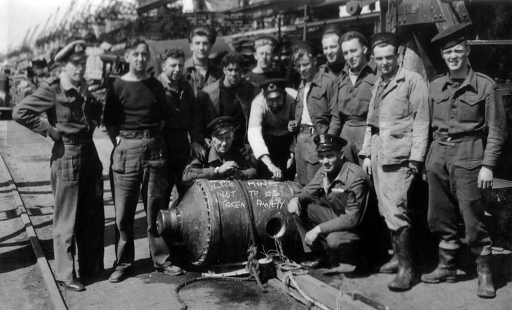 Lt George Gosse GC RANVR with 'P'Party 1571 after disarming GD 'Oyster' pressure mine at Bremen 7 May 1945